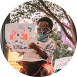 "black boy wearing sunglasses and mask holding finger painting with hands and reads ""RESPECT on my LIFE"""