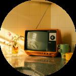 small orange vintage TV on kitchen counter
