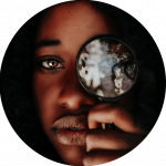black woman holding magnifying glass up to her eye