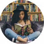 black teen girl crosslegged on couch reading